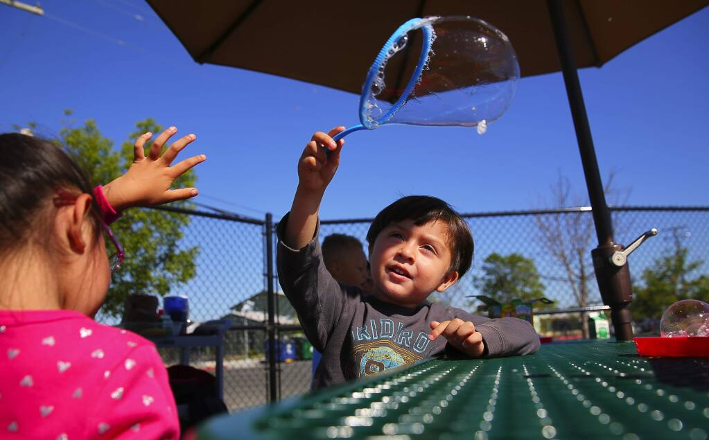 Dominic Ceja Morena, 3, makes bubbles on the playground during a Pre-K special day class at the Bellevue School District Early Learning Center, in Santa Rosa on Wednesday, June 14, 2017. (Christopher Chung/ The Press Democrat)