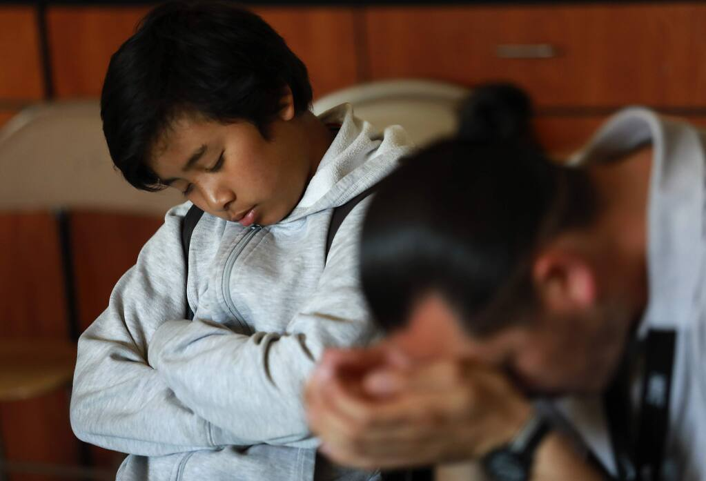 Eighth grader Justin Chhum, 13, closes his eyes during the 15 minutes of 'Quiet Time' at Cook Middle School in Santa Rosa. The meditative practice has led to increases in GPA and decreases in suspensions. (John Burgess/The Press Democrat)