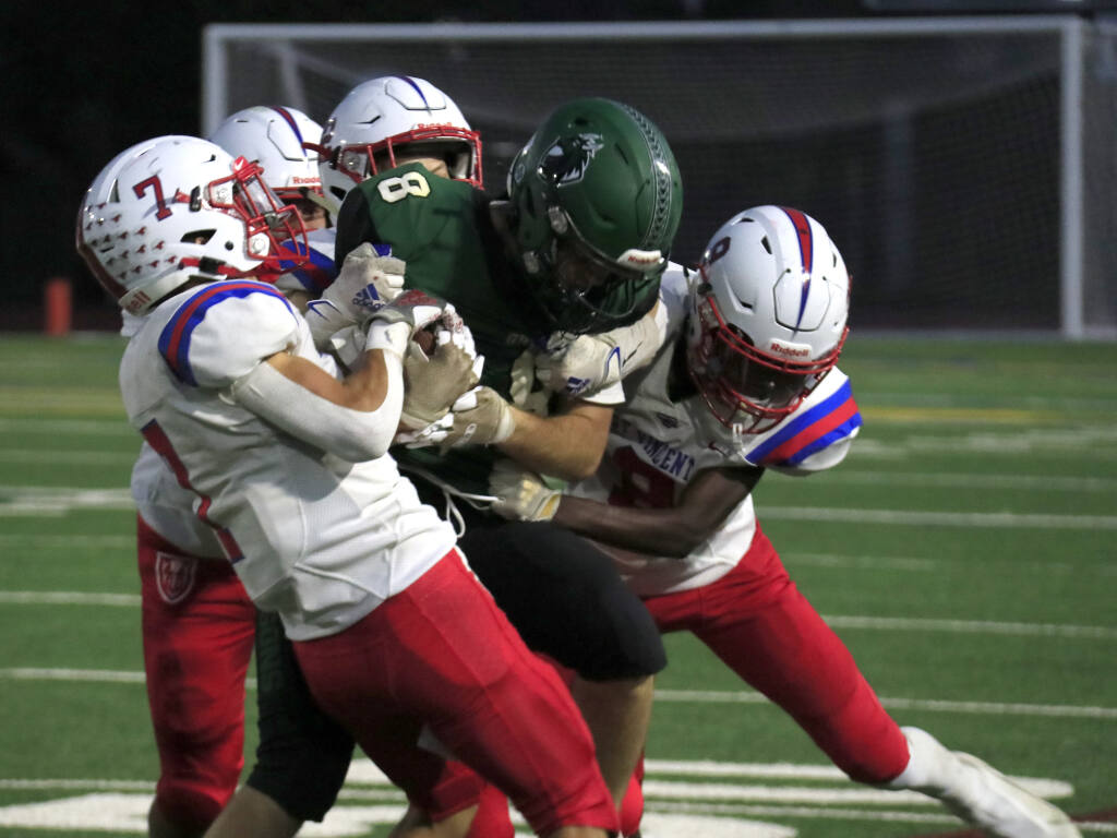 Sonoma Valley senior Tate Baker fought for every one of his 100 yards rushing against St. Vincent's grabby defensive line in the Sept. 17, 2021, Dragon loss at home, 42-0. (Christian Kallen/Sonoma Index-Tribune)