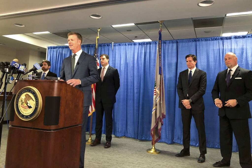 FILE - In this Sept. 30, 2019, file photo, U.S. attorney David Anderson announces criminal spy charges against San Francisco Bay Area tour operator Xuehua Edward Peng, in San Francisco. Federal prosecutors in Northern California say Peng was an illegal foreign agent who delivered classified U.S. natural security information to officials in China. Peng agreed to plead guilty to serving as an unregistered agent for China in exchange for a possible reduced prison sentence, Monday, Nov. 25, 2019. (AP Photo/Janie Har, File)