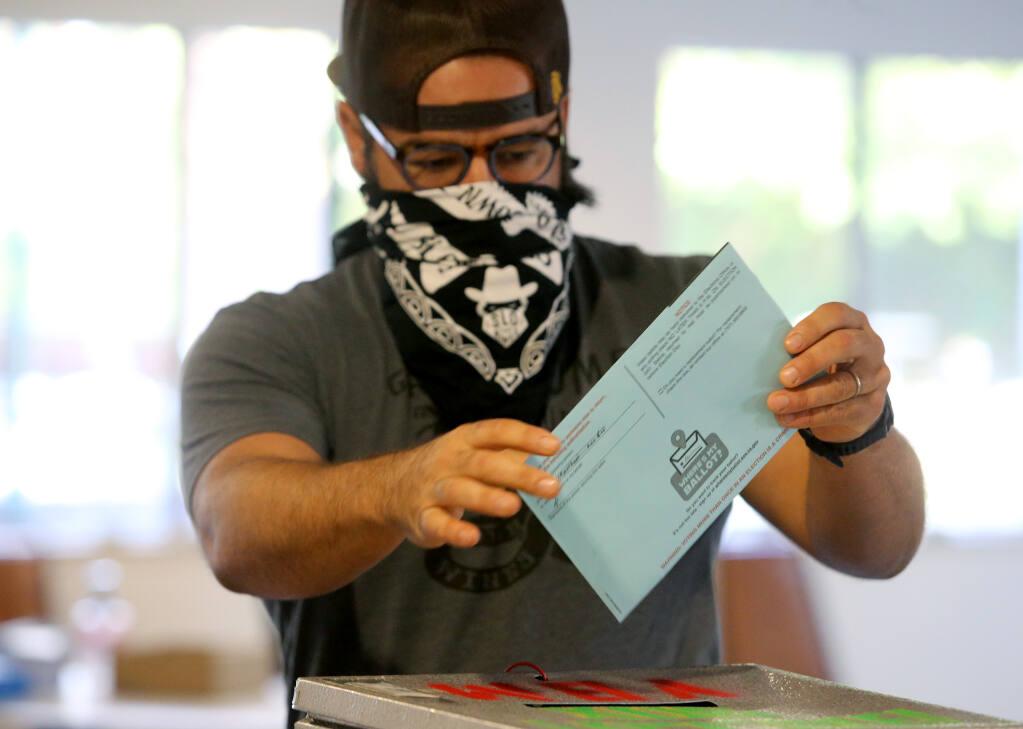 Brandon Allen casts his ballot at Petaluma Christian Church on Tuesday. (BETH SCHLANKER / The Press Democrat)
