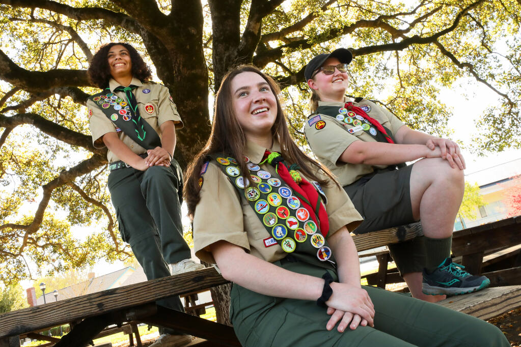 Sierra Robertson, left, 18, of Boy Scout Troop 848 in Petaluma, Ella Jacobs, 15, and Caterina Sharp, 19, both of Boy Scout Troop 55 in Santa Rosa, achieved the rank of Eagle Scout. Megan Fike, another pioneering Eagle Scout from Troop 55, is not pictured.  (Christopher Chung/ The Press Democrat)
