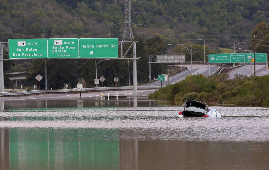 Flood waters forced the closure of all lanes in both directions of Highway 37 , east of the Hannah Ranch Road offramp, in Novato, on Monday, January 23, 2017. (Christopher Chung/ The Press Democrat)