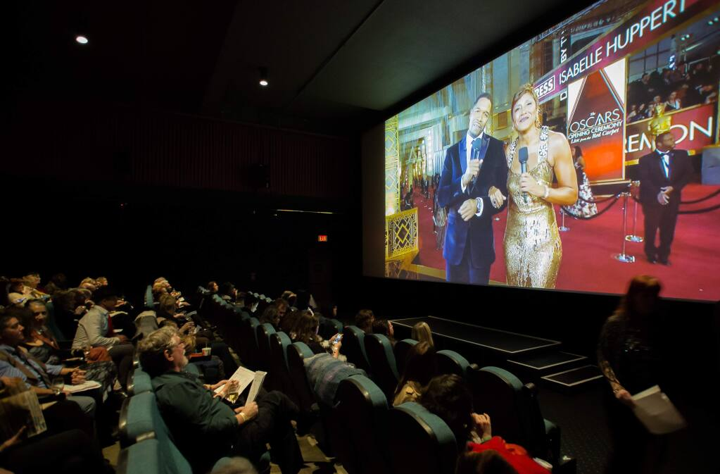 Guests watch a live-stream of the Academy Awards during an Oscar party at Rialto Cinemas in Sebastopol, Calif., Sunday Feb. 26, 2018. The fundraiser for Food for Thought featured movie trivia contests, raffle prizes and the Academy Awards live on the big screen. This year's Oscars viewing at Rialto Cinemas will be on Feb. 24. (Jeremy Portje / For The Press Democrat)