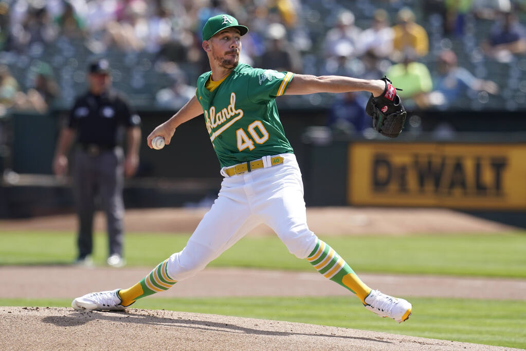 The Oakland Athletics' Chris Bassitt pitches against the Seattle Mariners during the first inning in Oakland on Thursday, Sept. 23, 2021. (Jeff Chiu / ASSOCIATED PRESS)