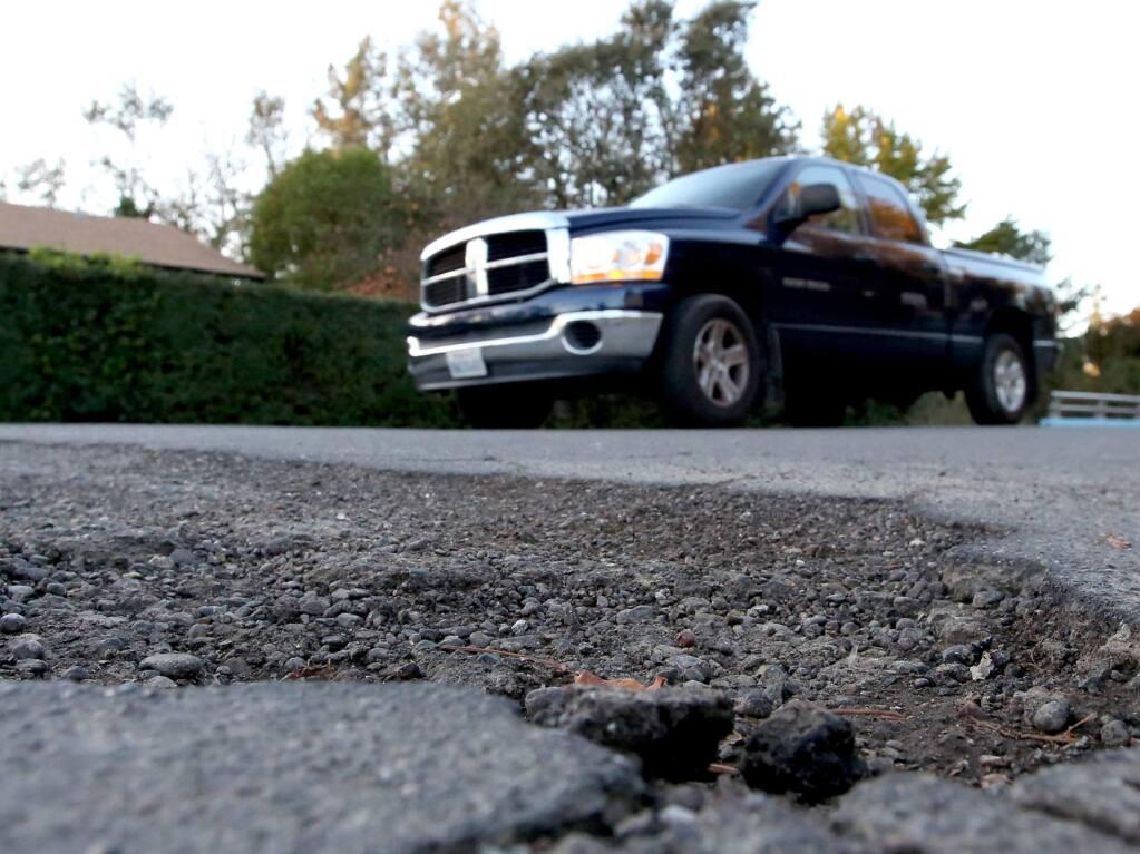 A pickup travels along McMinn Avenue near Delport Avenue in Santa Rosa in 2014. (PD FILE)