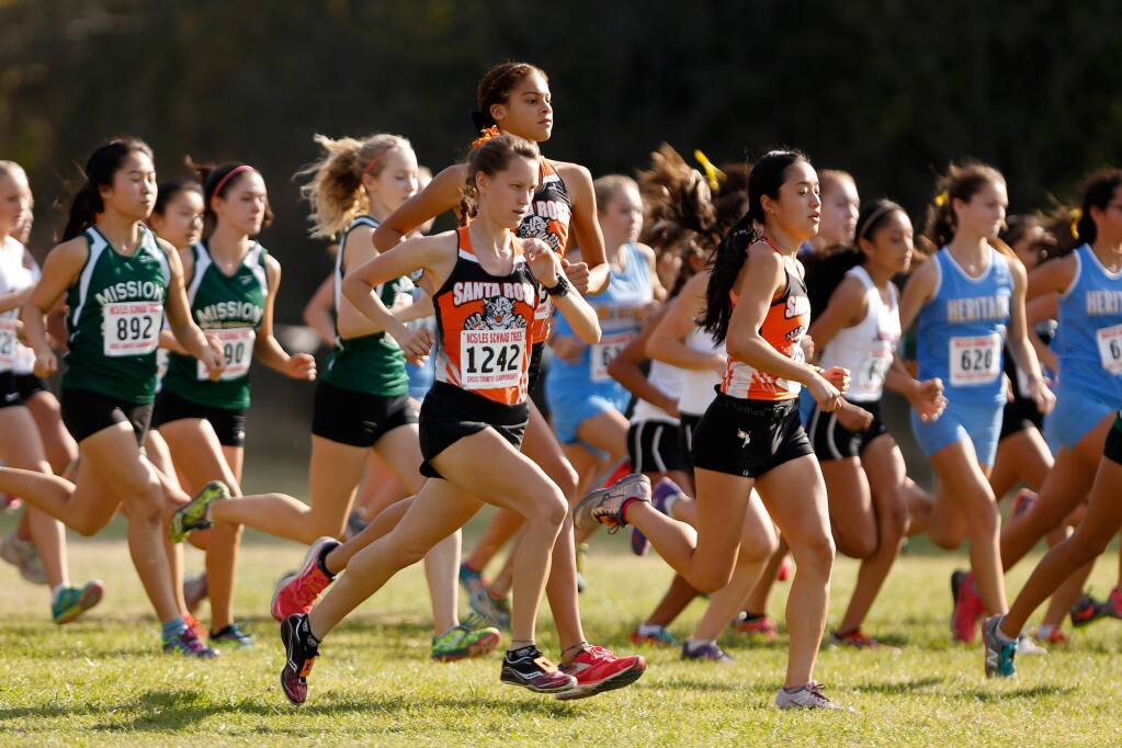 Santa Rosa's Delaney White, center front, Kirsten Carter, and Aimee Holland compete in the Division I girls race during the NCS Cross Country Championship in Hayward on Nov. 21, 2015. (Alvin Jornada / The Press Democrat)