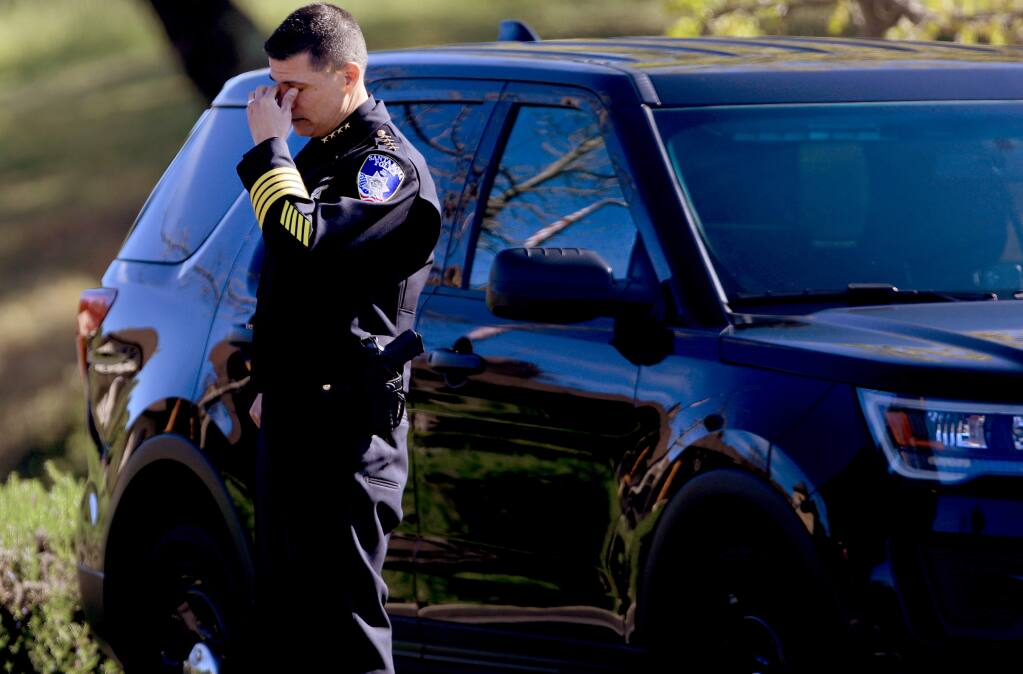Santa Rosa Police Chief Rainer Navarro wipes away tears after a law enforcement procession to Tulocay Cemetery and Funeral Home, Friday, April 3, 2020, honoring SRPD Detective Marylou Armer, who died of complications from the coronavirus. (Kent Porter / The Press Democrat) 2020