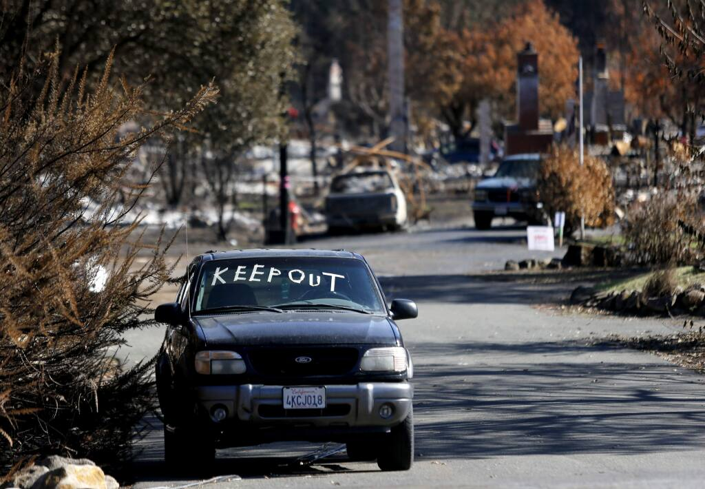 A message for people to stay away is marked in tape on a SUV on Parker Hill Road in Santa Rosa, on Tuesday, November 7, 2017. (BETH SCHLANKER/ The Press Democrat)
