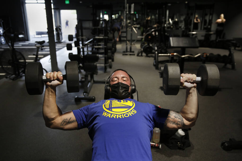 Connor McGoldrick lifts weights inside at Sonoma Fit gym in Petaluma on Sunday, March 14, 2021. (Beth Schlanker / The Press Democrat)