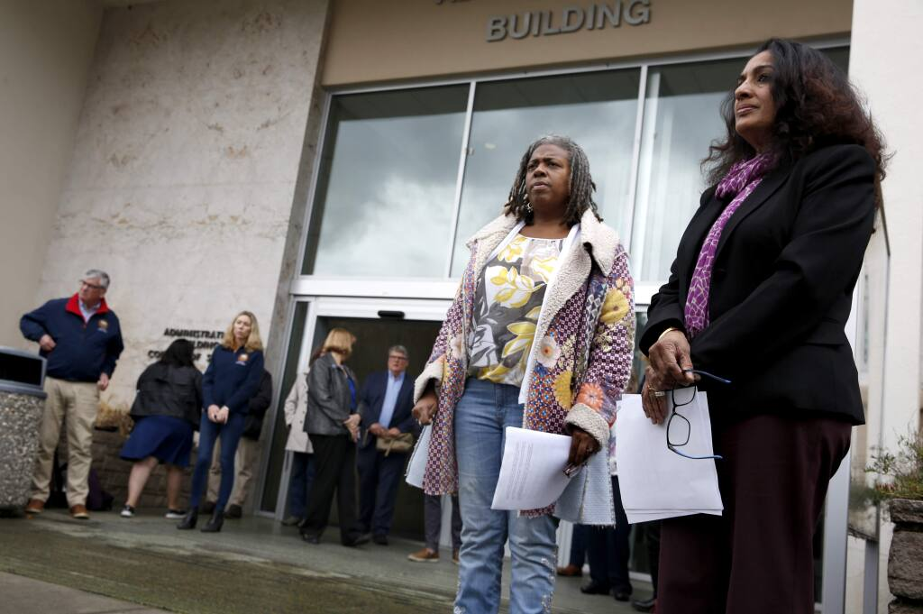 (FILE PHOTO) Dr. Sundari R. Mase, Health Officer for the County of Sonoma, right, and Barbie Robinson, the Director of the Department of Health Services, attend a press conference about the first community spread case of the coronavirus and the local response. Photo taken outside the Sonoma County administration building in Santa Rosa on Sunday, March 15, 2020. (BETH SCHLANKER/ The Press Democrat)