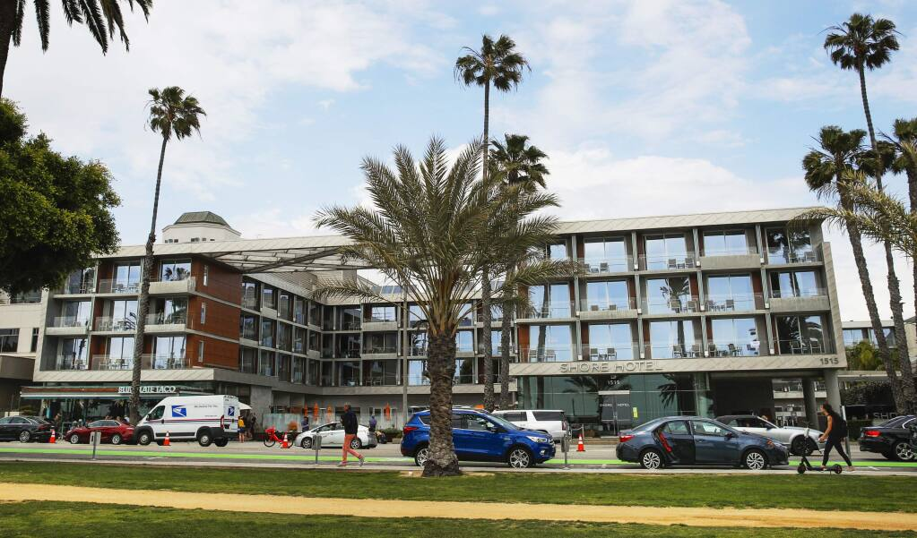 This Monday, May 6, 2019 photo shows the Shore Hotel in Santa Monica, Calif. The California Coastal Commission is fining the hotel's developer $15 million for building the high-priced hotel near the Santa Monica Pier after obtaining a permit for a property with moderately priced rooms. Officials say Sunshine Enterprises perpetrated a 'bait and switch' while violating the state's landmark Coastal Act, which enshrines public access to beach areas. The commission is expected to approve the penalty Wednesday, May 8, 2019, and also recommend an additional $9.5 million in mitigation fees. (AP Photo/Jae C. Hong)