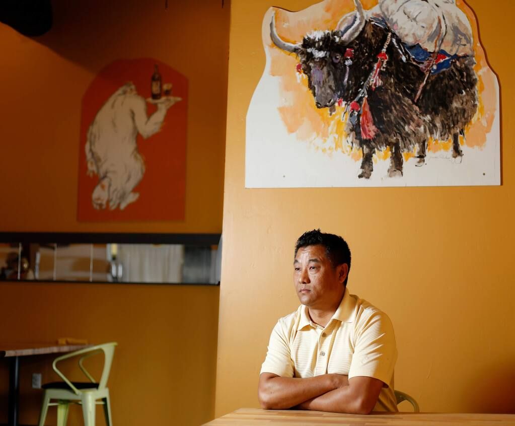 Pemba Sherpa, co-owner of restaurants Yak and Yeti, in Napa, and La Casa, in Sonoma, poses for a portrait at Yak and Yeti restaurant in Napa, California, on Saturday, April 28, 2018. Sherpa is a naturalized U.S. citizen who emigrated from Nepal. (Alvin Jornada / The Press Democrat)