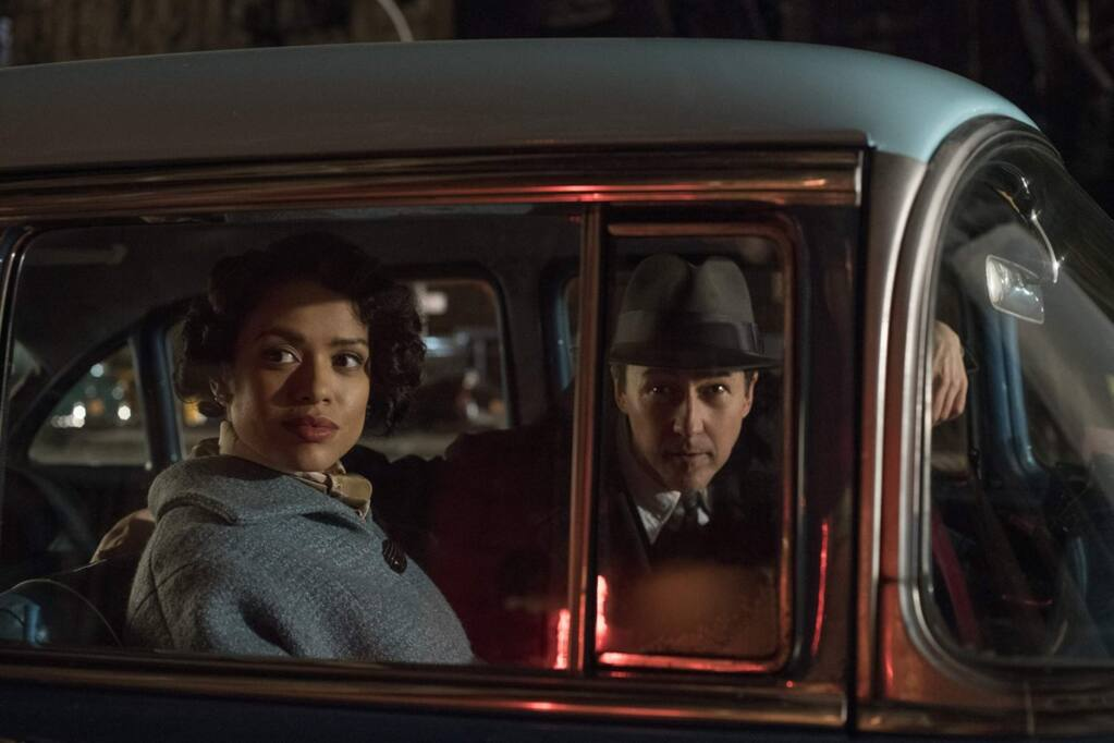 Edward Norton as Lionel Essrog and Gugu Mbatha-Raw as Laura Rose in 'Motherless Brooklyn,' a story set in 1957 New York City, about a private investigator with Tourette's syndrome who must solve the murder of his mentor (Bruce Willis). (Warner Bros. Pictures)