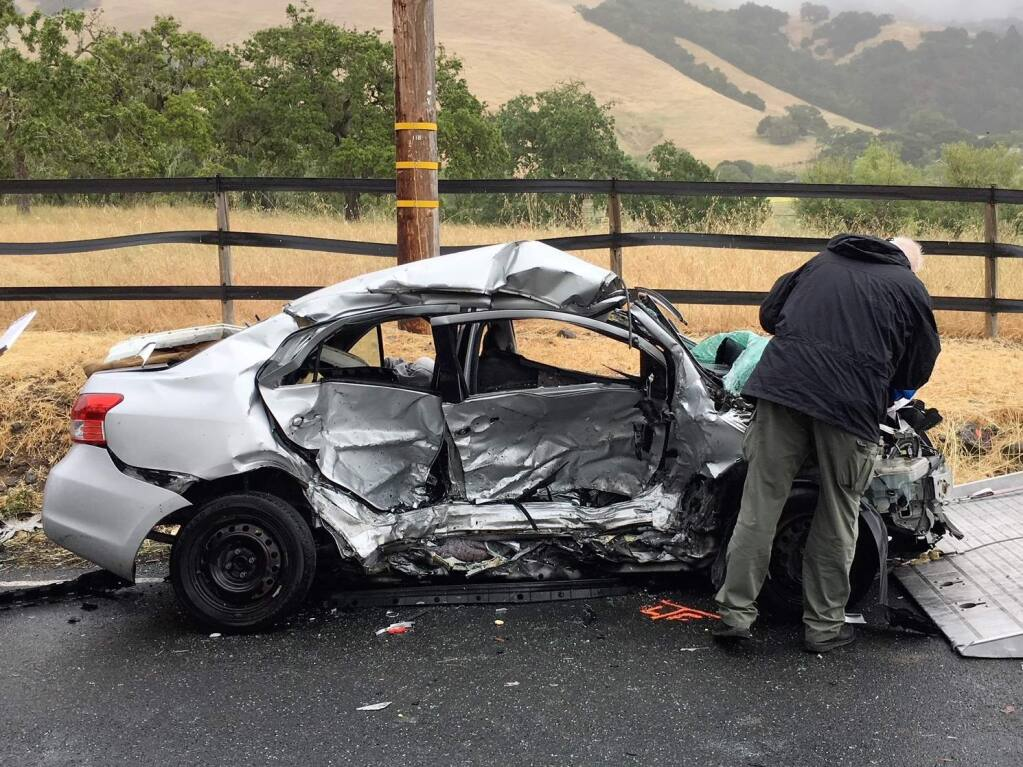 California Highway Patrol officers investigate the scene of a fatal accident on Bennett Valley Road close to Matanzas Creek Winery near Santa Rosa on Friday, May 25, 2018. (KENT PORTER/ PD)
