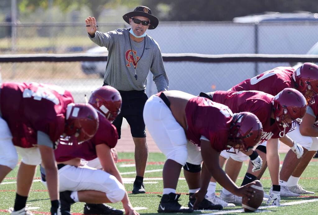 Cardinal Newman varsity football head coach Richard Sanchez directs his team during practice in Santa Rosa on Tuesday, August 24, 2021.  (Christopher Chung/ The Press Democrat)
