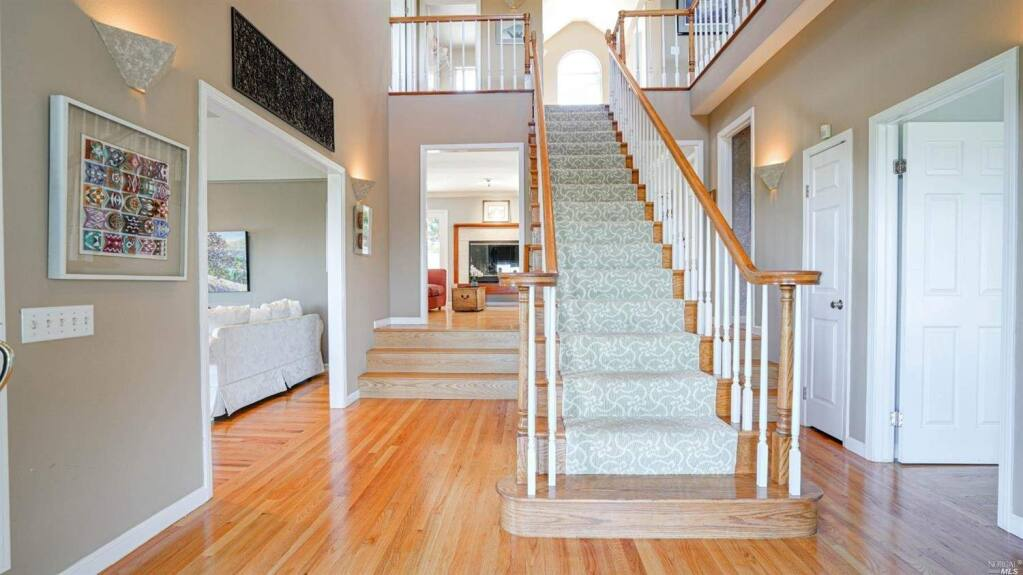 A grand central staircase at 17 Buckeye Court, Petaluma. Property listed by Peg and Jeremy King/ Coldwell Banker, coldwellbanker.com, 707-769-4328. (Courtesy NORCAL MLS)