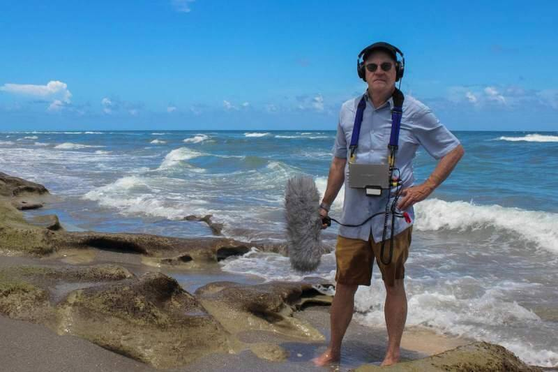 Former NPR reporter Alex Chadwick is shown in Miami while working on a story about climate change. (BURN/ Sound Vision Productions)