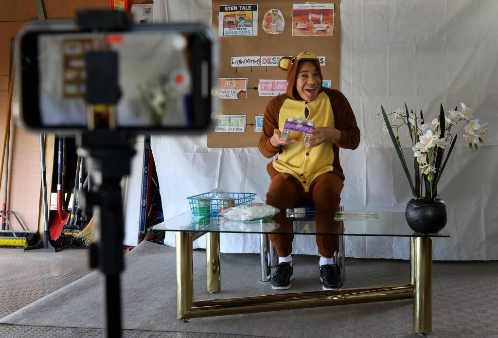Ryan Kurada records himself teaching a STEM project related to 'Goldilocks and The Three Bears' for his University Elementary at La Fiesta transitional kindergarten and kindergarten split class in his garage in Rohnert Park on Monday, April 6, 2020. (Christopher Chung/ The Press Democrat)