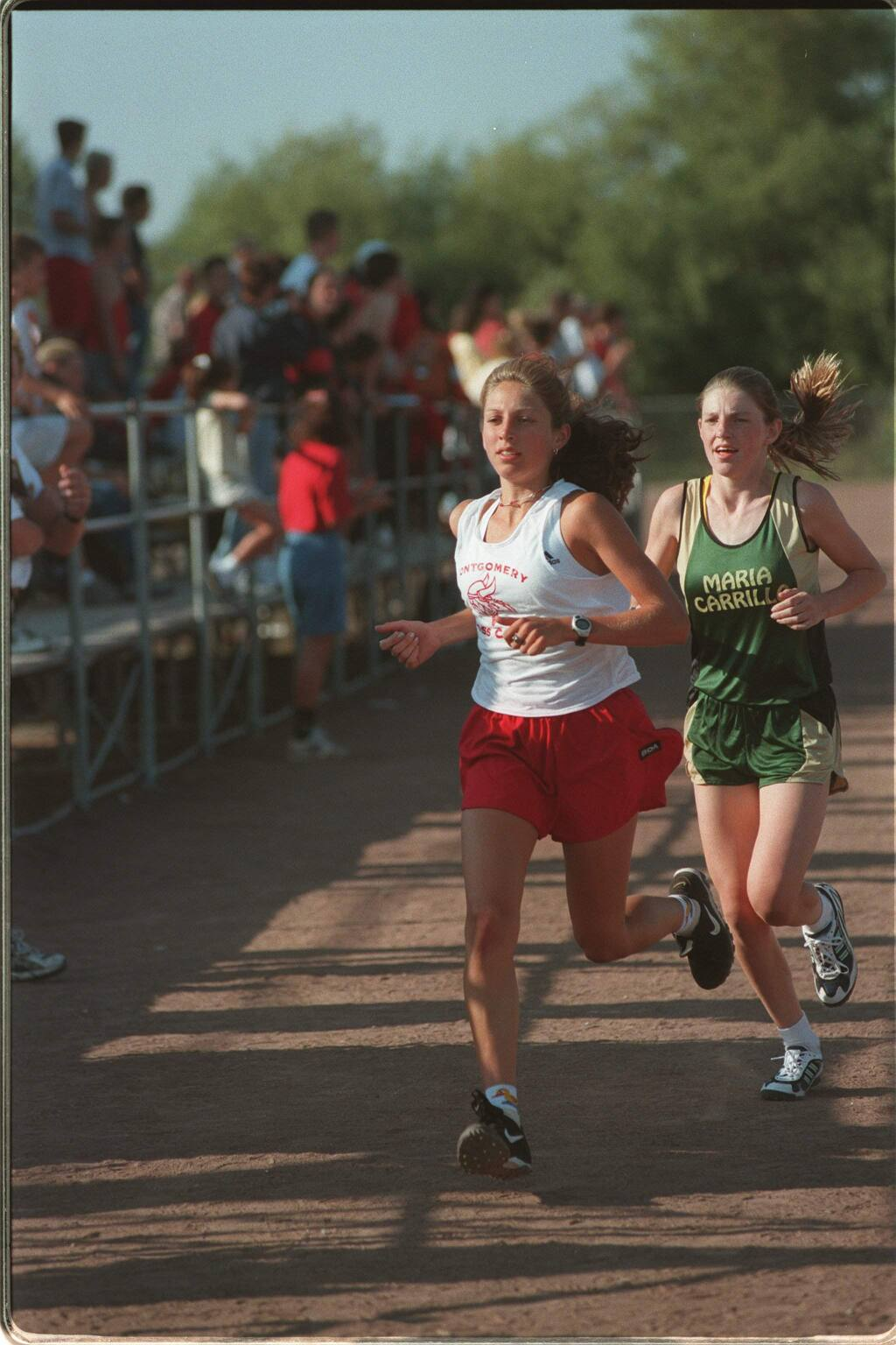 Montgomery's Sara Bei leads Maria Carrillo's Jenny Aldridge out of the stadium at Rancho Cotate High at the start of the cross country race; they finished in the same order. (JEFF KAN LEE/ PD)