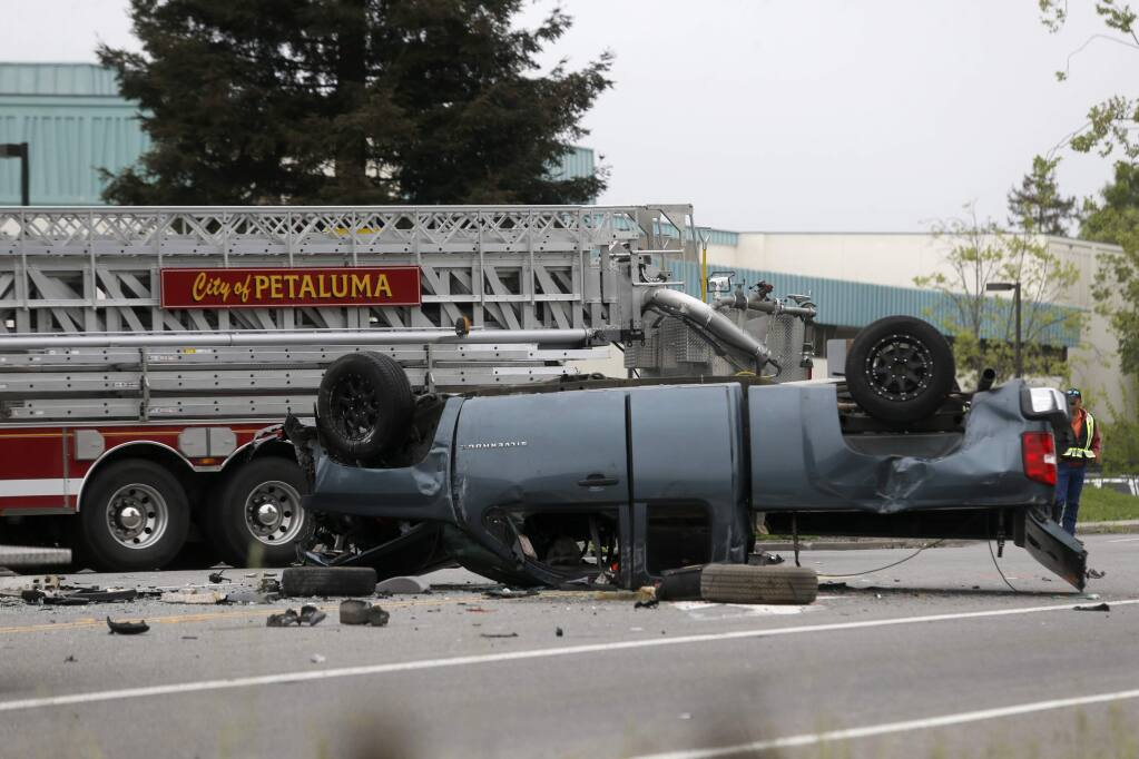 Petaluma police and fire crews respond to the scene of a fatal crash involing at least 6 vehicles on Lakeville Hwy at the S. McDowell Extention and Pine View Way in Petaluma on Tuesday, April 24, 2018. (Beth Schlanker/ The Press Democrat)