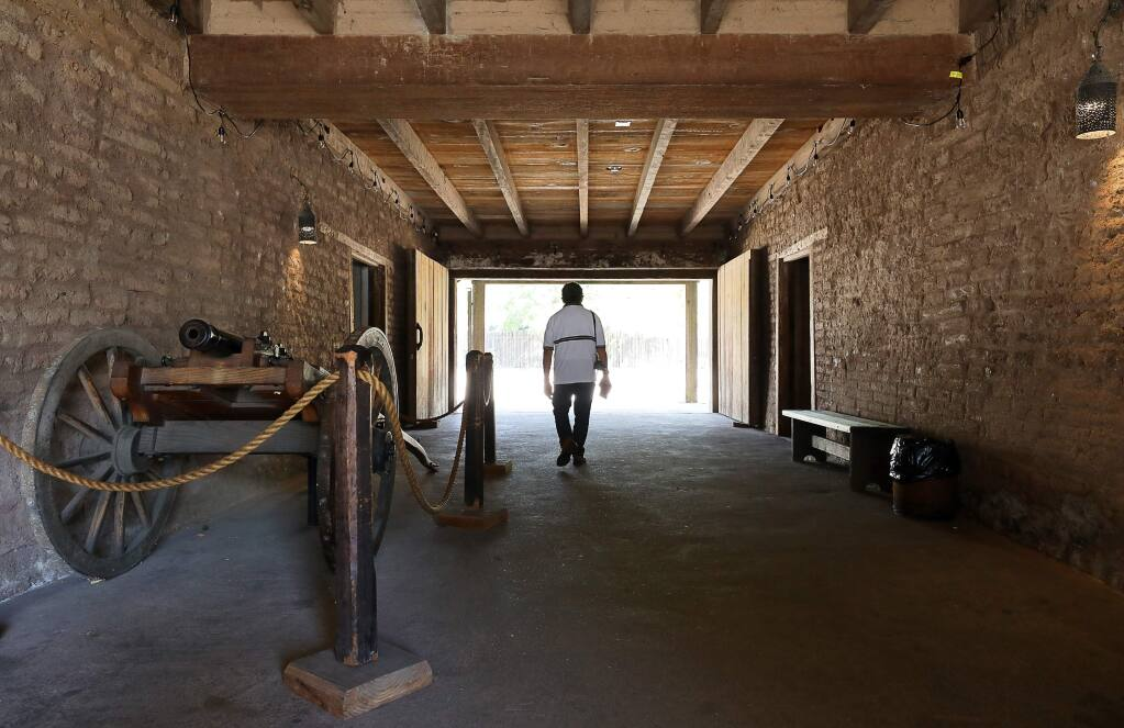 A tourist walks through the main entrance of the Sonoma Barracks at the Sonoma State Historic Park, in downtown Sonoma on Wednesday, September 18, 2019. (Christopher Chung/ The Press Democrat)