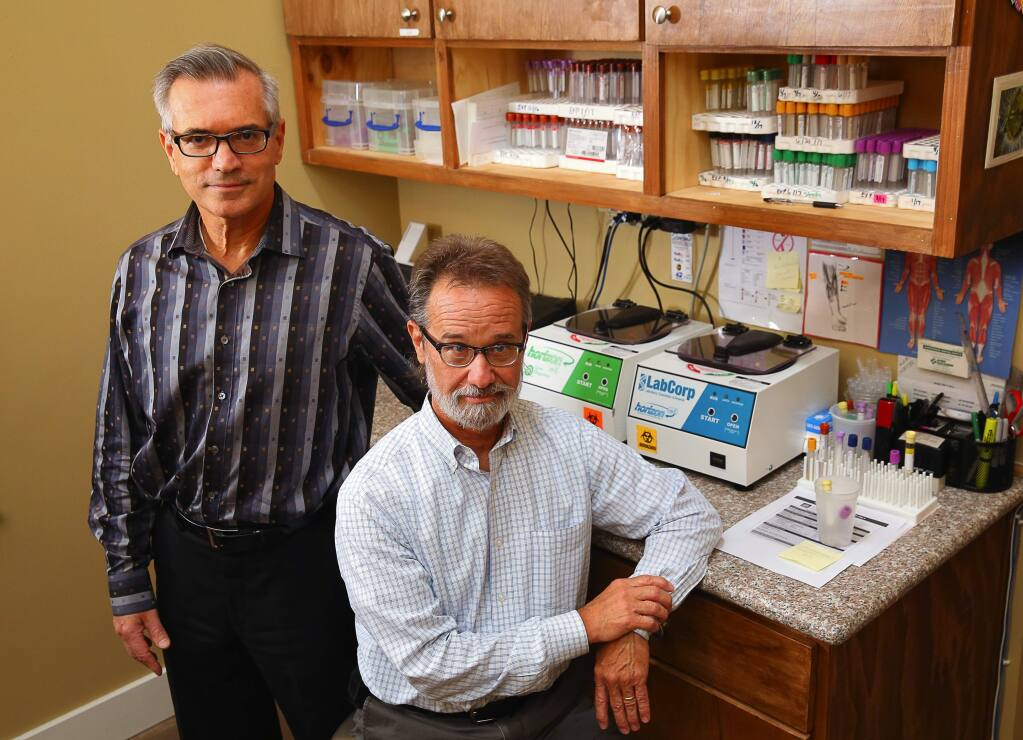 Dr. Eric Gordon, left, and Dr. Wayne Anderson, at Gordon Medical Associates, initiated a study that found evidence, for the first time, that chronic fatigue syndrome is a physical disorder.(Christopher Chung/ The Press Democrat)