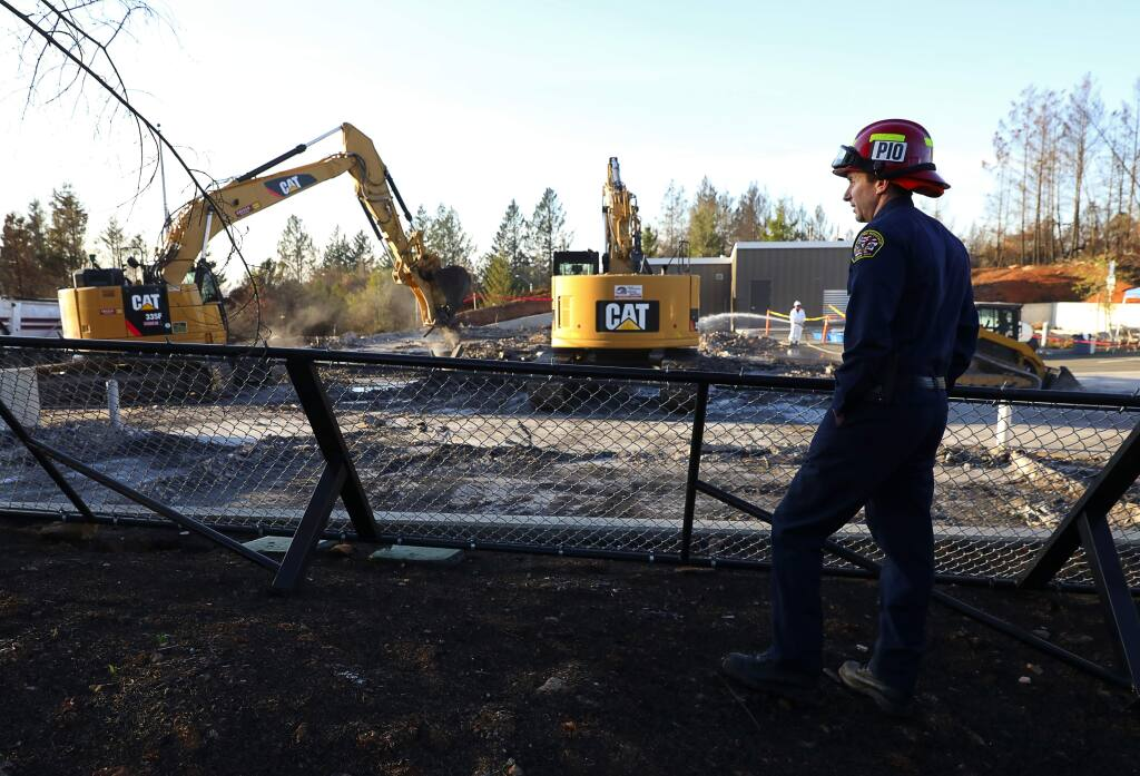 (File photo) Santa Rosa Assistant Fire Marshal Paul Lowenthal watches excavators remove debris from the burned down Santa Rosa Fire Station 5 on Newgate Court, off of Fountaingrove Parkway in Santa Rosa on Thursday, December 14, 2017. (Christopher Chung/ The Press Democrat)