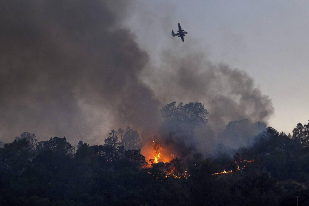 Flames from the Quail Fire burn along a hillside near Winters, Calif., on Saturday, June 6, 2020. (AP Photo/Noah Berger)