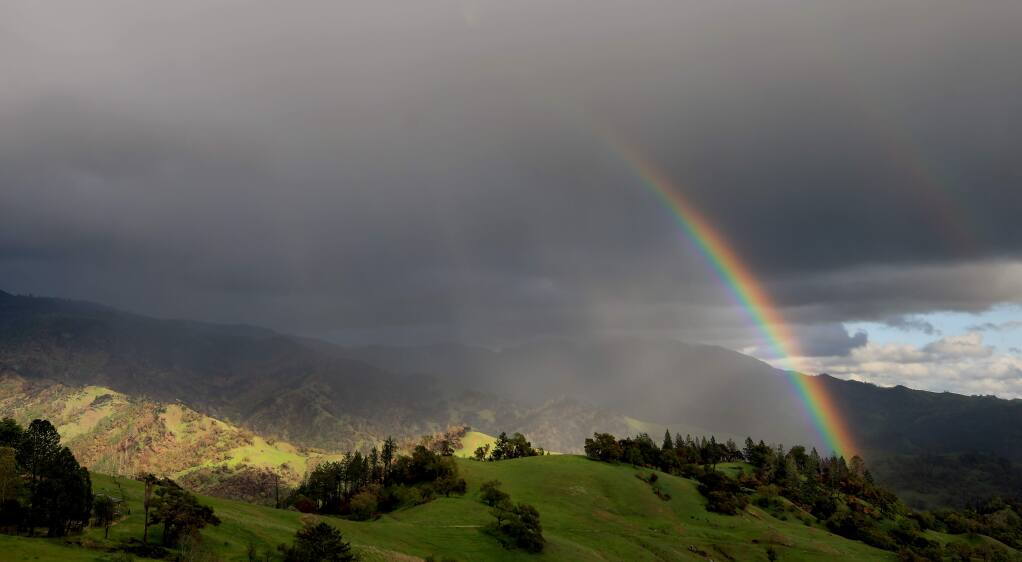 A rainbow forms at the foot of Mt. St. Helena, Tuesday, March 24, 2020 as thunderstorm rolls through. A frost advisory has been posted by the National Weather Service Thursday morning. (Kent Porter / The Press Democrat) 2020