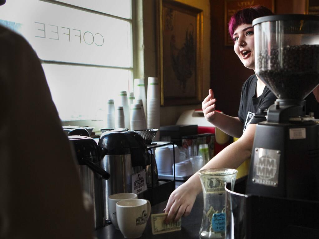 Barista Lais Barone takes a customer's order at Petaluma Coffee & Tea.(CRISSY PASCUAL/ARGUS-COURIER STAFF)