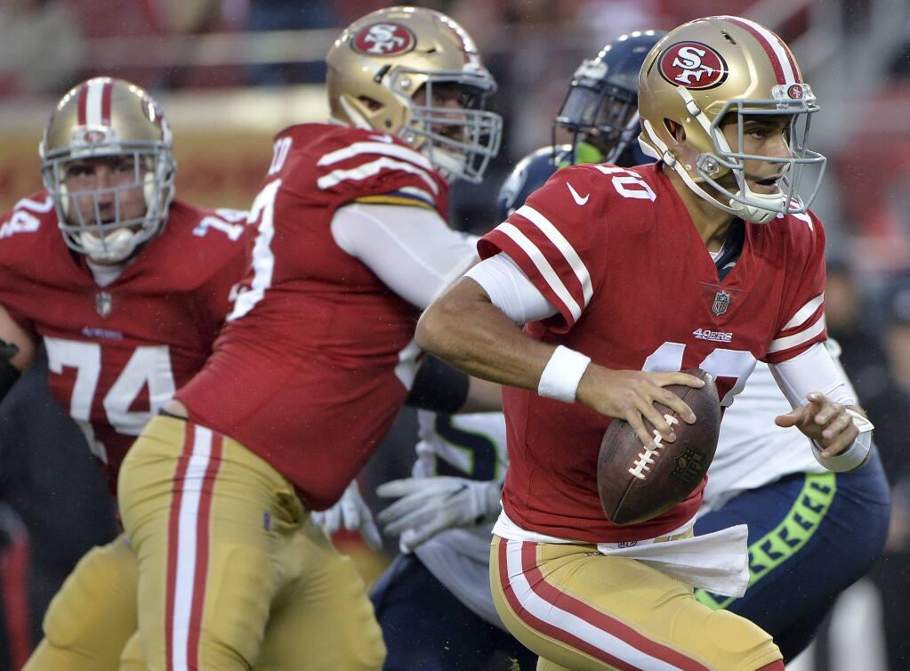 San Francisco 49ers quarterback Jimmy Garoppolo runs against the Seattle Seahawks during the second half on Sunday, Nov. 26, 2017, in Santa Clara. (AP Photo/Don Feria)