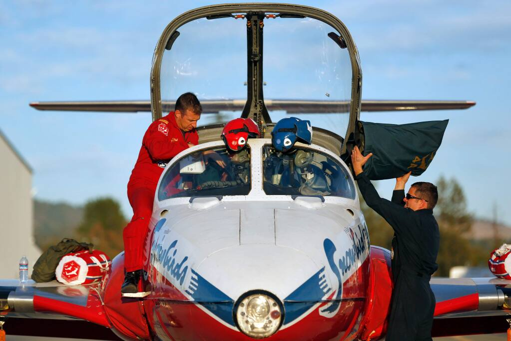 Snowbird 4 Captain Phillipe Roy, left, and Aviation Technician Master Corporal Russel Egler, members of the Canadian Forces Snowbirds air demonstration squadron unload their aircraft as they arrive at Sonoma County Airport in Santa Rosa, California on Thursday, September 24, 2015. (Alvin Jornada / The Press Democrat)