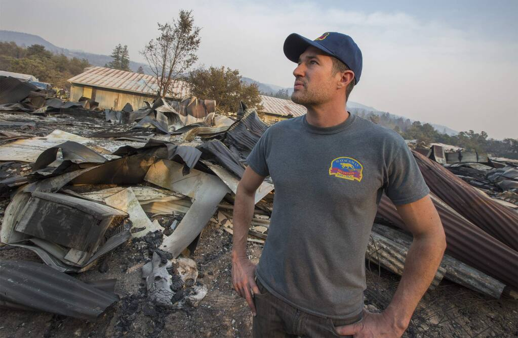 Erich Pearson, CEO of SPARC, surveys the damage done to their Glen Ellen marijuana farm during the early hours of the Nuns Fire, Oct. 9, 2017. (Photo by Robbi Pengelly/Index-Tribune)