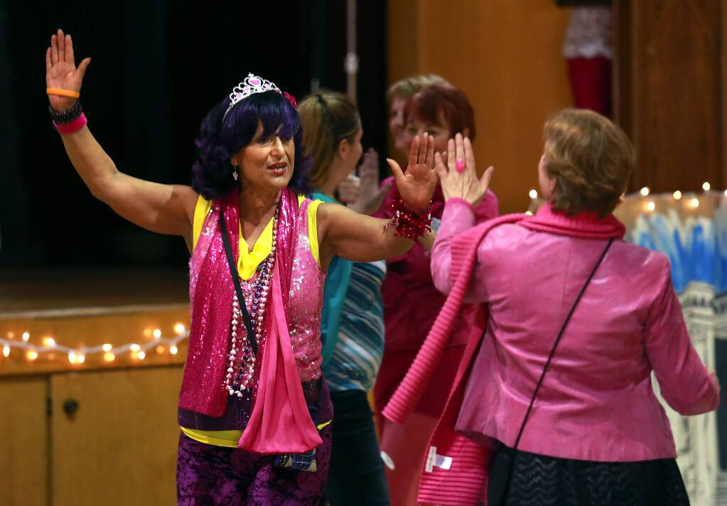 Ms. Rose Rodriguez, of Rohnert Park, dances with a flash mob at the start of the 1 Billion Rising For Justice held to raise awareness against violence towards women and girls. (Photo by John Burgess/The Press Democrat)
