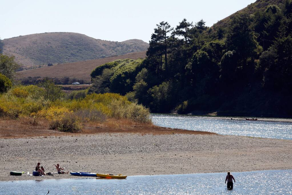 Kayakers rest at a quiet spot on the Russian River near Jenner on Sunday, Sept. 6, 2015. (Alvin Jornada / The Press Democrat)