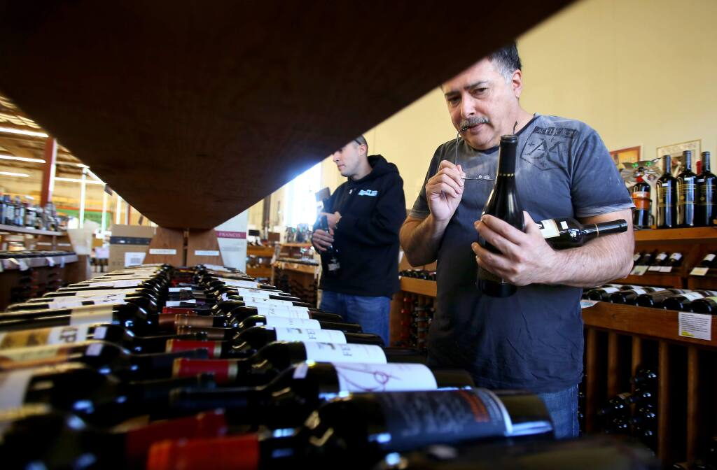 Pablo Corina, right, shops for wine with his son, Christopher, at Bottle Barn in Santa Rosa on Wednesday, January 28, 2015. (Christopher Chung/ The Press Democrat)