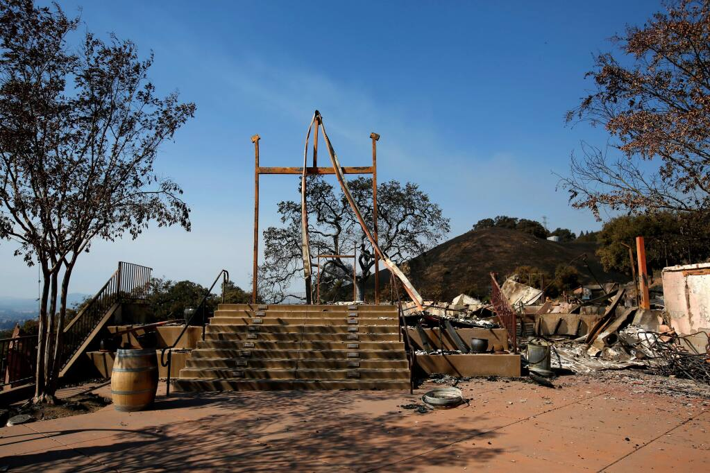 The wide set of stairs once led up to the Paradise Ridge Winery tasting room, in Santa Rosa, California, on Thursday, October 12, 2017. The winery's tasting room, wine production facility and parts of the vineyards and sculpture gardens were destroyed when the Tubbs fire swept through the area three days earlier. (Alvin Jornada / The Press Democrat)