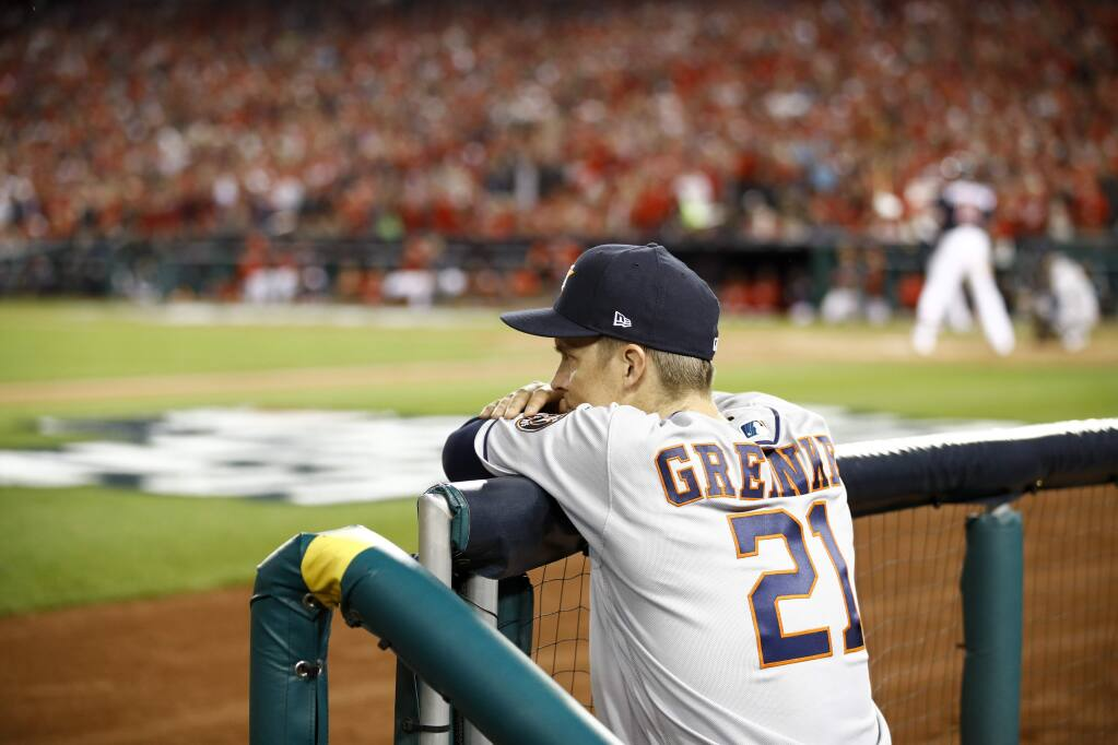 Houston Astros starting pitcher Zack Greinke watches during the sixth inning of Game 3 of the baseball World Series against the Washington Nationals Friday, Oct. 25, 2019, in Washington. (AP Photo/Patrick Semansky)