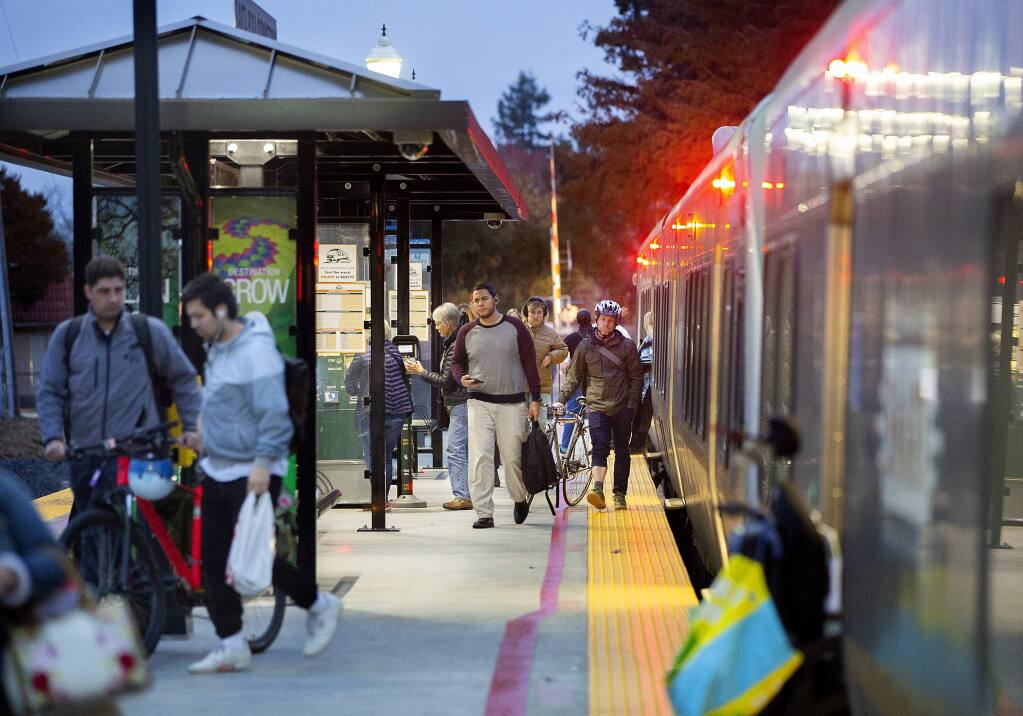 SMART riders exit the train at the Railroad Square station in Santa Rosa. SMART refuses to release its daily and weekly ridership numbers despite repeated records requests. (photo by John Burgess/The Press Democrat)