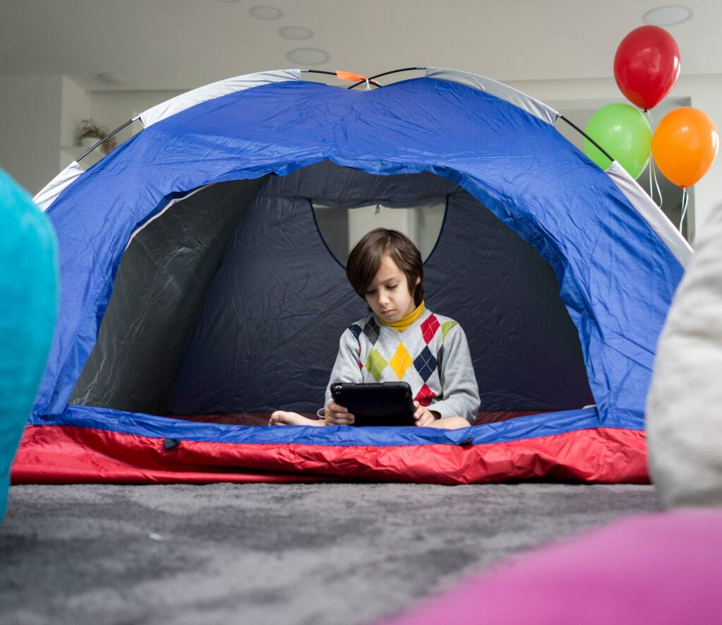 Go camping in your living room: Make an otherwise scary situation into something exciting for your kids. Set up a tent or create a blanket fort in your living room where the kids can play, sleep or watch a movie.