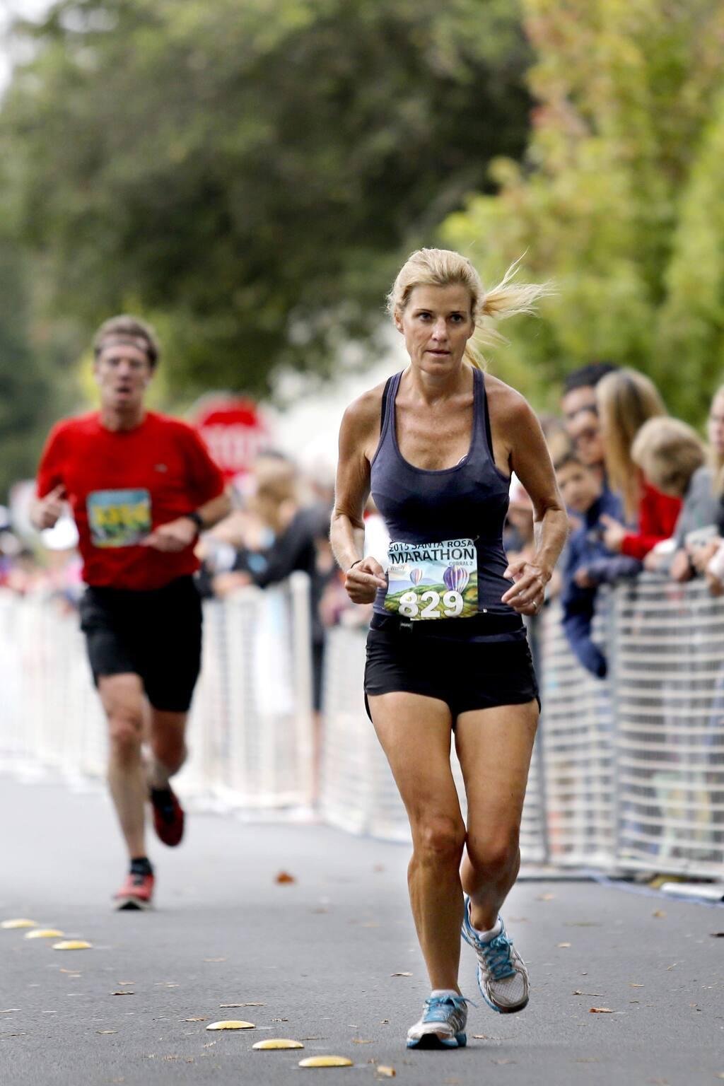 Wendy Jennings approaches the finish line of the Santa Rosa Marathon in Santa Rosa, on Sunday, August 23, 2015. (BETH SCHLANKER/ The Press Democrat)