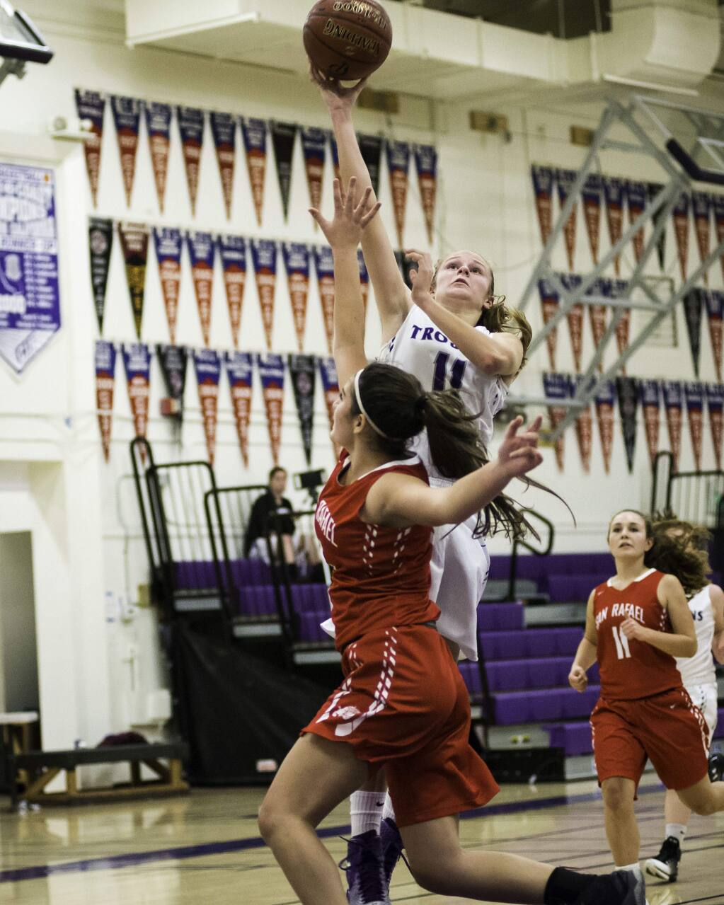 RICH LANGDON/FOR THE ARGUS-COURIERPetaluma's Nicole Costa rises above a San Rafael defender to score two of her game-high 14 points in the T-Girls victory.