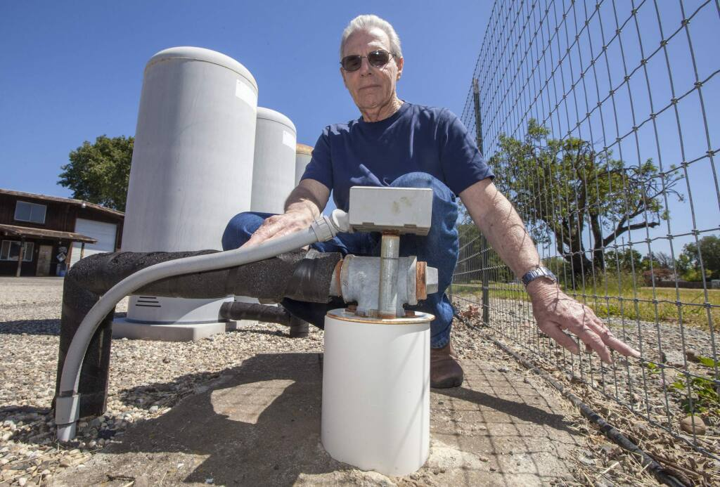 Ray Larbre, of Larbre Well Drilling & Pumps, at one the three wells on his Arnold Drive Property. This well reachers a depth of 1000 feet and is used to monitor groundwater levels on the west side of the valley. Larbre, who's been keeping records since the 1990s, measures these levels twice a year, in the spring and in the fall, and says that since he started keeping records, the groundwater level has declined about 60 feet. (Photo by Robbi Pengelly/Index-Tribune)