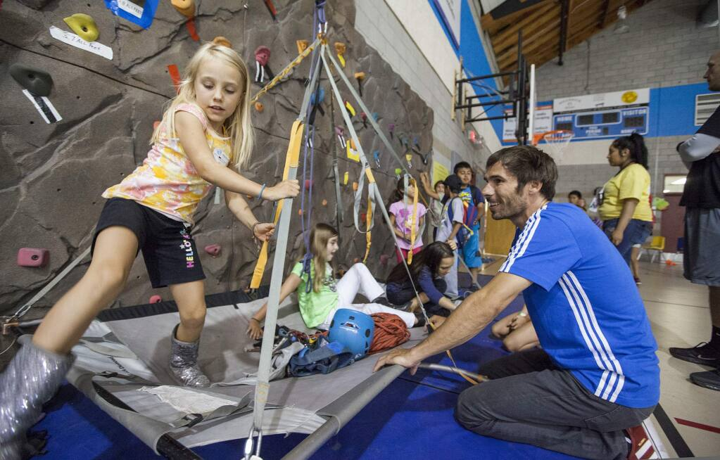 Kevin Jorgeson, who recently completed a historic ascent of El Capitan's Dawn Wall in Yosemite National Park, visited the Boys and Girls Clubs of Sonoma Valley in June, 2015. Club members were invited to experience the PortaLedge, a system designed for sleeping thousand of feet off the ground. (Photos by Robbi Pengelly/Index-Tribune)