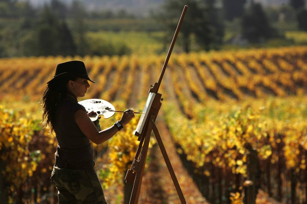 Our beautiful vineyards, especially when the fall colors take over. Here, artist Jayashri Triolo captures the colors of a fall vineyard in Sebastopol. (John Burgess/PD FILE)