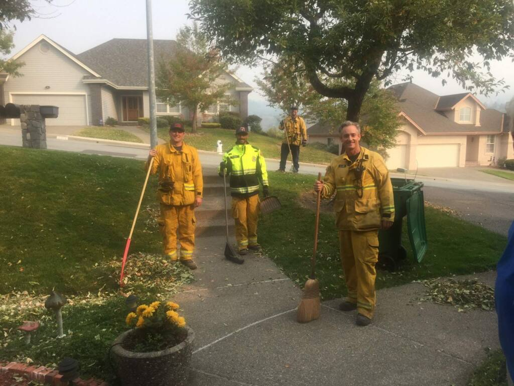 Pasadena firefighters stopped to help Oakmont residents clean up their yard, on Wednesday, Oct. 18, 2017. (Photo by Ingrid Brasche)