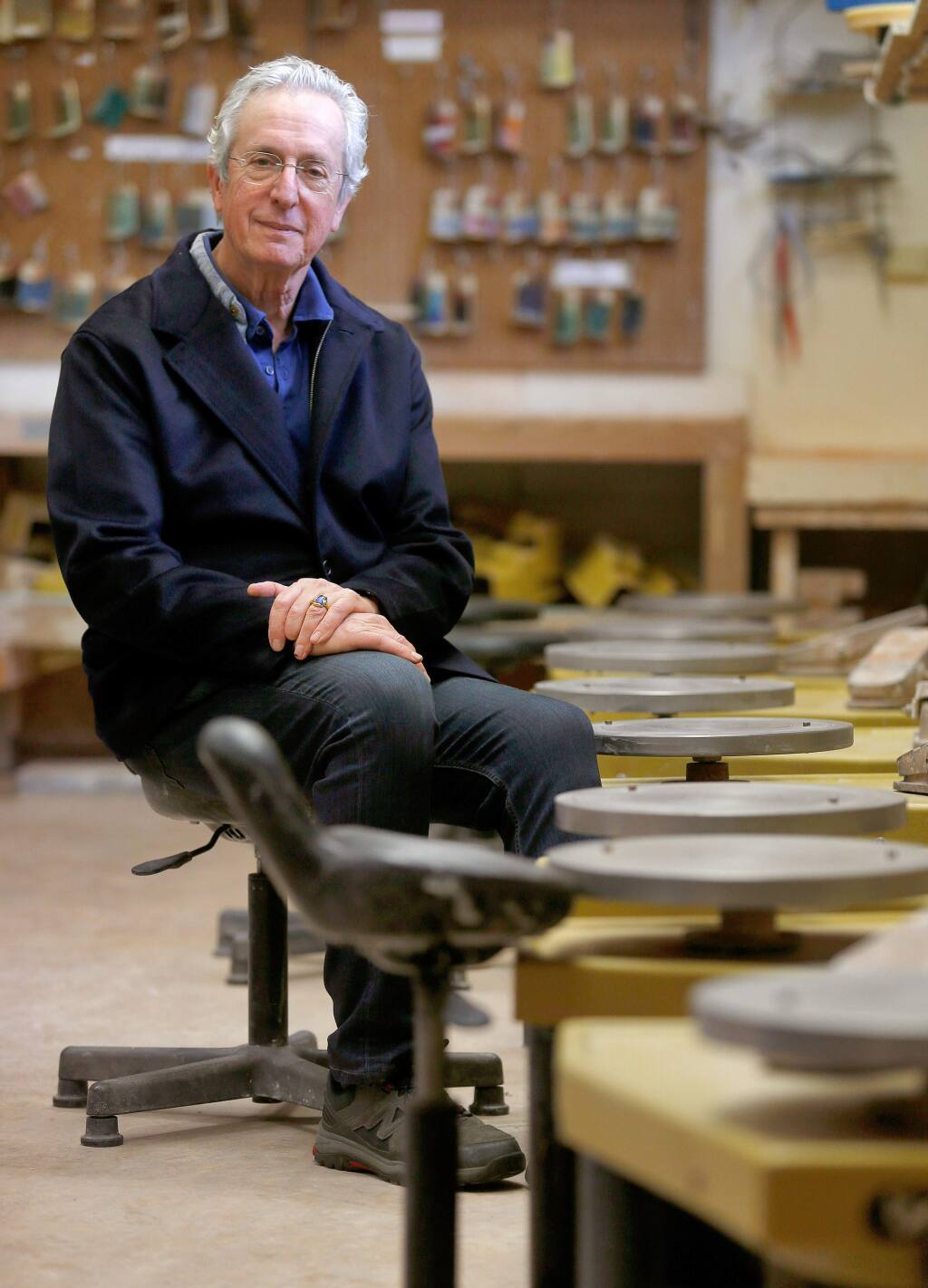 Robert Brent, board member of Sebastopol Center for the Arts and inventor of the Brent Pottery Wheel, poses for a portrait beside a row of his invention at Sebastopol Center for the Arts, in Sebastopol, California on Friday, January 5, 2018. (Alvin Jornada / The Press Democrat)