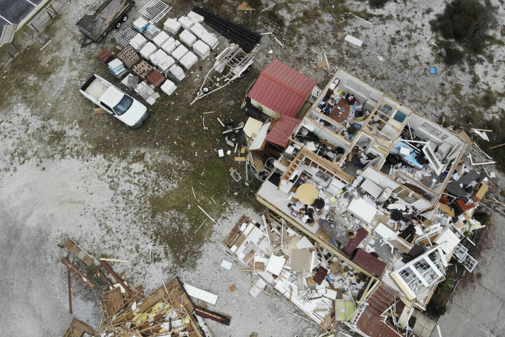 A damaged business is seen in the aftermath of Hurricane Sally, Thursday, Sept. 17, 2020, in Perdido Key, Fla.  (AP Photo/Angie Wang)