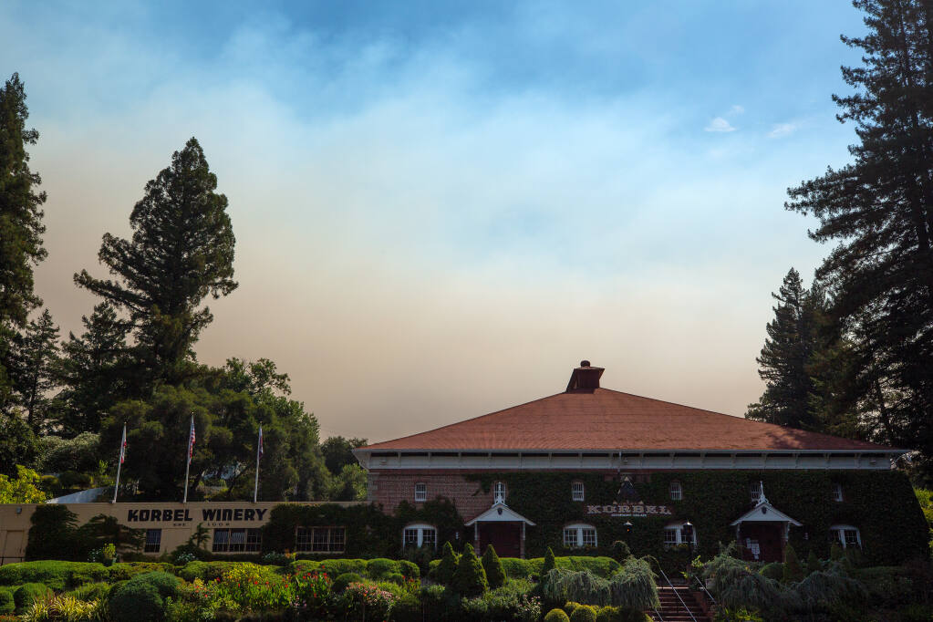 Smoke from the Walbridge fire rises above Korbel Champagne Cellars in Guerneville, California, on Wednesday, Aug.19, 2020. (Alvin A.H. Jornada / The Press Democrat)
